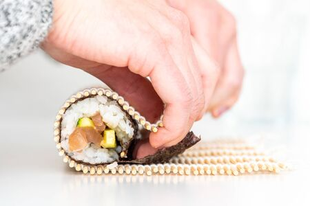Sushi roll Japanese dish tuna and cucumber with spicy wasabi maki rolled by hand