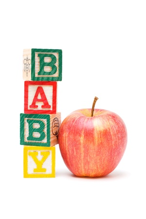toy blocks: Wooden blocks and apple with baby Stock Photo