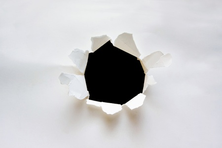 Breaking paper with hole photo
