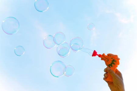 Transparent bubbles over the sky photo