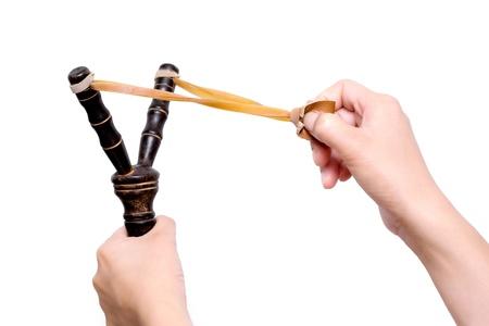 Hand Holding Aiming Slingshot Stock Photo - 12727120