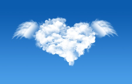 A heart shaped cloud formation against clear blue sky and flying with wings  photo