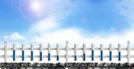 A row of  white fence in the blue sky  photo
