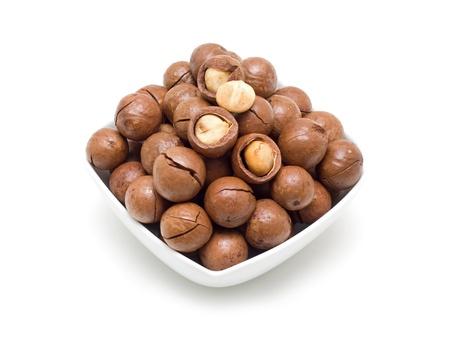 Macadamia in bowl Foto de archivo