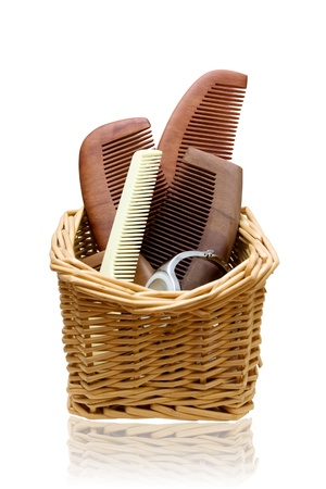 hair brush: Wooden combs in the Rattan basket Stock Photo