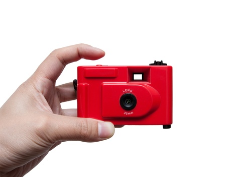 Camera in a hand Stock Photo - 18873720