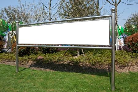 Blank advertising board in park photo