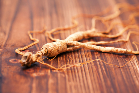 ginseng: Ginseng on a wood background Stock Photo