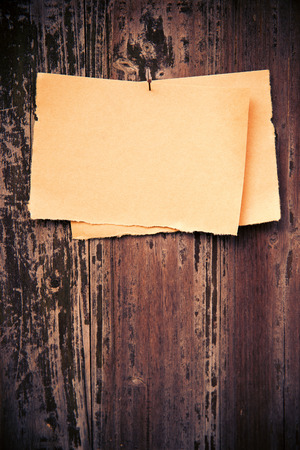 paper board: Old brown paper on wood board background Stock Photo