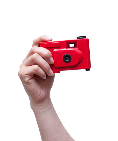 point and shoot: Camera in a hand isolated on white background