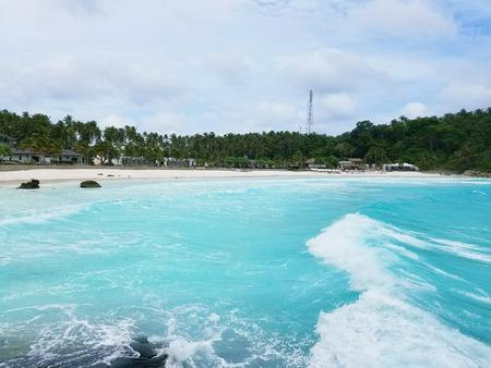 Beautiful sandy beach on a tropical island Stock Photo