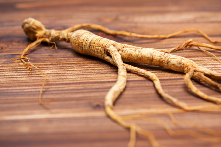 Dry ginseng on a wood background