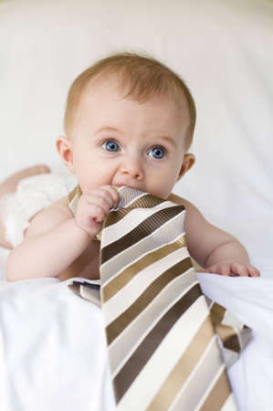 Young baby girl with tie around her neck on a white background Stock Photo - 4202010