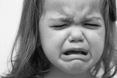 child crying: Baby girl crying in black and white Stock Photo