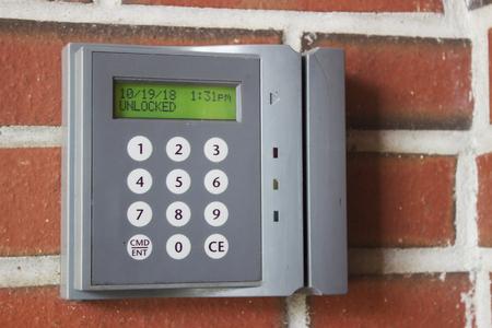 Unlocked card access machine on a brick wall