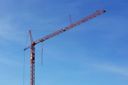 Building Crane Over Blue Slightly Cloudy Sky