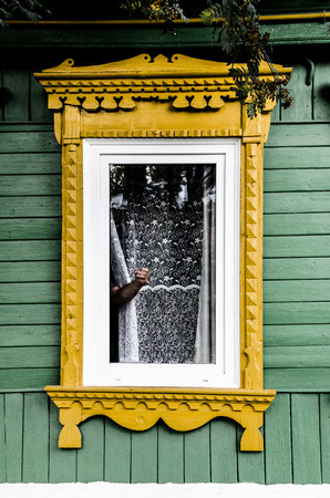 angry hand: Angry hand in traditional Russian window in Tarusa