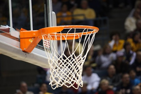 hoops: Basketball rim in focus with a glass backboard. Stock Photo