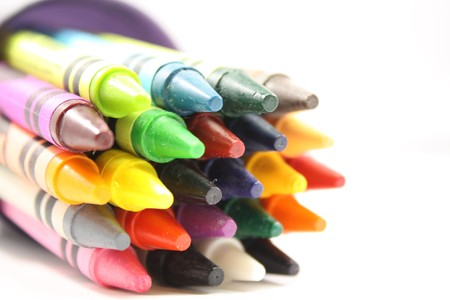 Colorful arrangement of crayons in a cup.