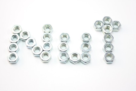 Nuts spelling out the word NUT on an isolated white background. Stock Photo - 4274222