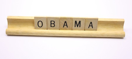 Wooden tiles spell out the word Obama.