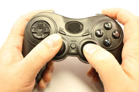 wii: Hands holding a video game controller isolated on white.