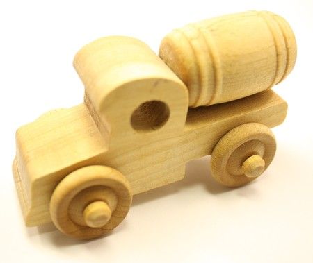 Wooden toy truck, cement mixer on white. photo