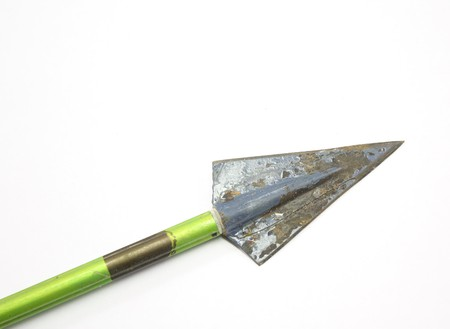 Old vintage arrow and broadhead on white background. photo