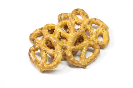 pretzel stick: An appetizing pile of pretzels isolated on white.