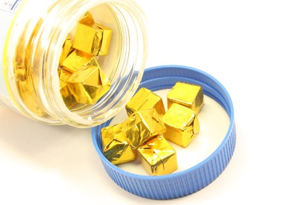 Bullion cubes being opened and ready for cooking.