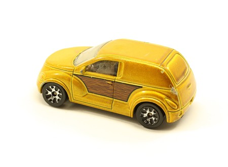 Vintage toy brown car in used condition on white.