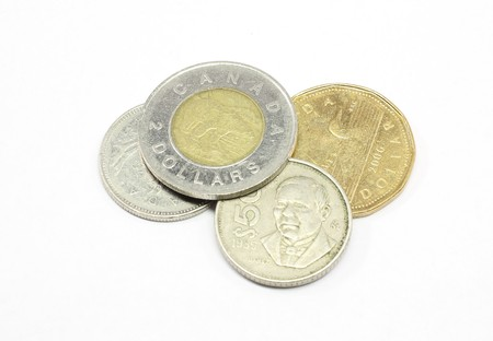 Canadian coins isolated on a white background.
