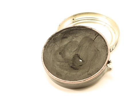 Black shoe polish and can isolated on white background. photo
