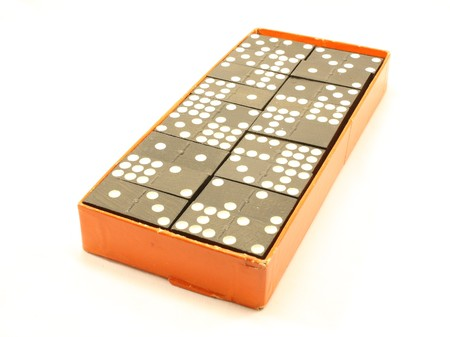 Box of dominoes isolated on a white background. photo