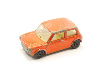 A toy compact car from the junkyard isolated on a white background. photo