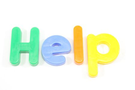 Refrigerator magnets spell out the word help.