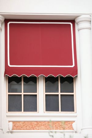 An Italian style store shop window with a nice red canopy. Stock fotó
