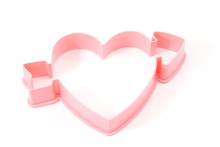 Heart shaped cookie cutter on a white background. Reklamní fotografie