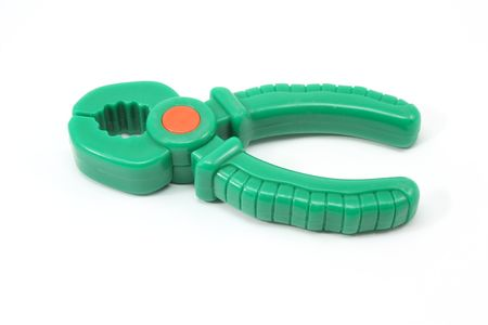 Childs green, plastic, toy pliers on a white background Banco de Imagens