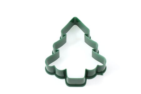 cutter: Christmas tree cookie cutter on a white background.
