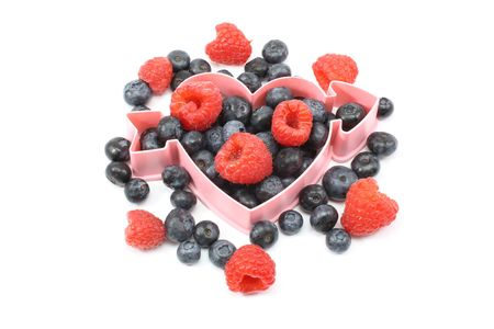 Heart healthy fresh berries, blueberries, raspberries, strawberries with heart shape. Stock Photo - 5262736