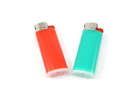 butane: Two colorful lighters on a white background.