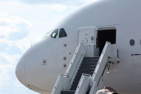 Rolling stairs placed at the airplane doors, ready for boarding  Stock Photo - 5317680