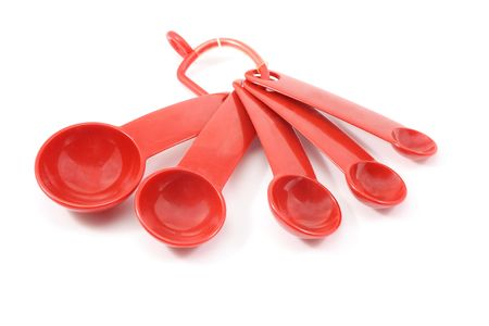 Red measurement spoons on a white background.