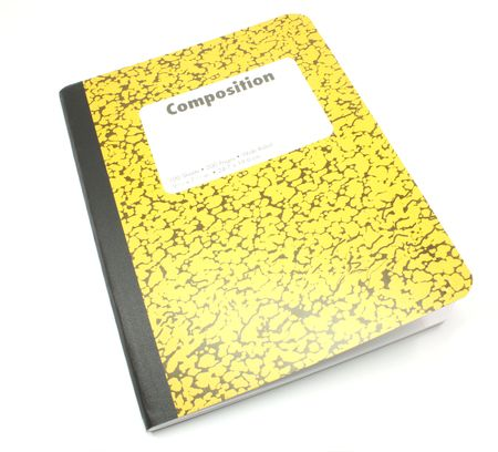 notebook: A yellow composition notebook on a white background. Stock Photo