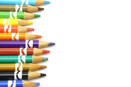 uneven edge: Uneven row of wooden colored pencils aligned along the left edge photographed on a white background Stock Photo