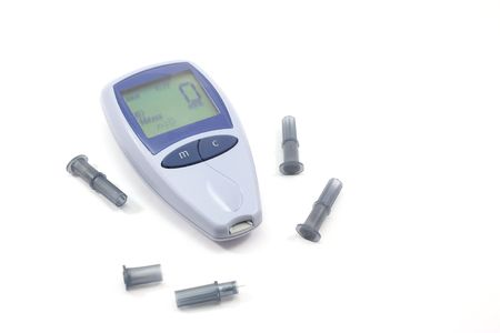 Glucometer with lancets on a white background.
