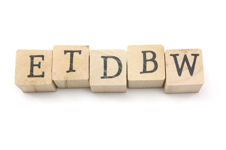 custumer: ETDBW-Easy to do business with wooden blocks photgraphed on a white background