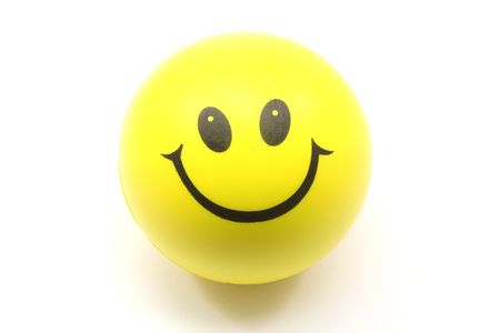 Yellow Smiley Face Stress Ball photographed on a white background Stock Photo - 5463893