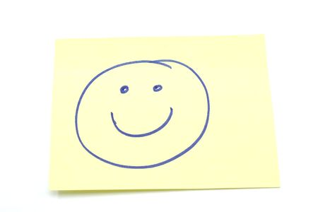 smiley: Smiley Face drawn on a yellow stickey note photographed on a white background Stock Photo